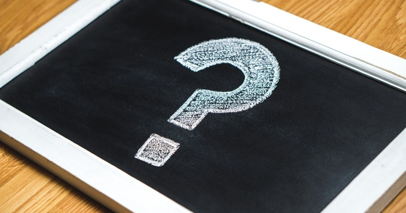Handheld chalkboard with drawn question mark